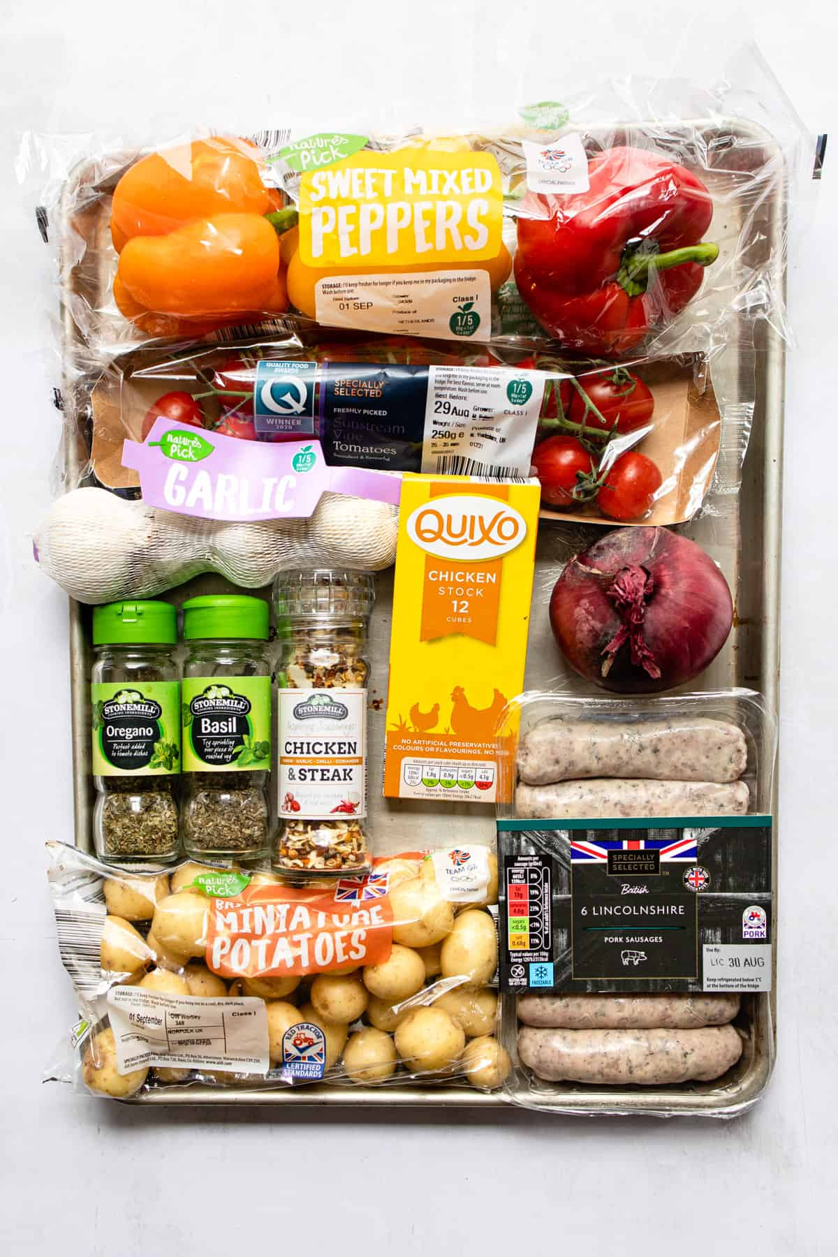 ingredients for sausage and peppers traybake- Healthy Aldi recipes