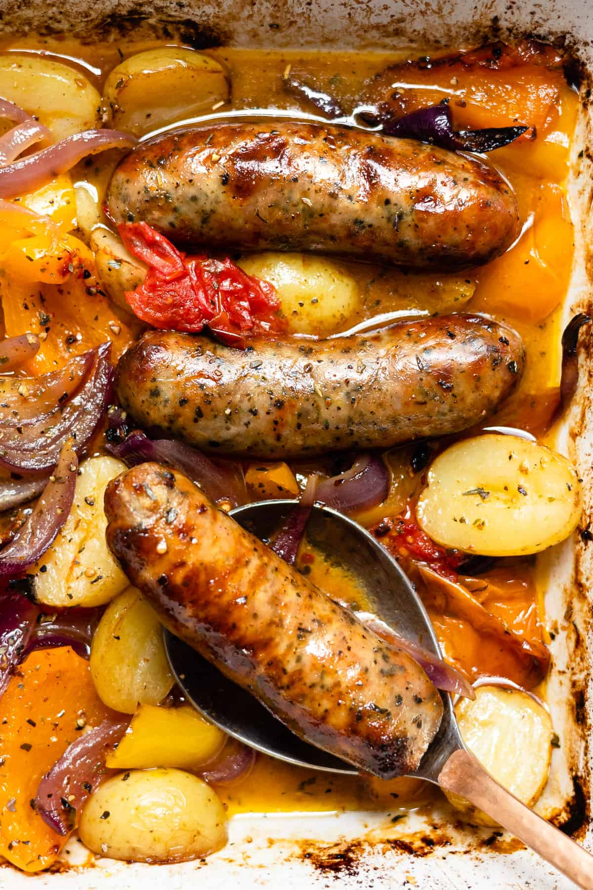 Sausage traybake with a spoon- Aldi meal ideas