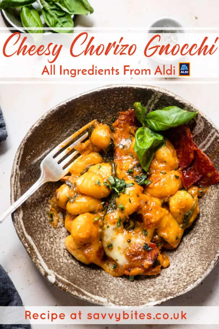 chorizo gnocchi in a bowl with basil and cheese